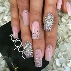 Glitter studs on light pink nail polish, as well as designed to create an artistic blend of nail designs with symbols and studs ❤️ laquenailbar