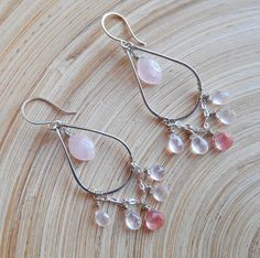 Blushing color and luster combine charmingly on these gorgeous Caresse chandelier hoop earrings! Jewelry to love, kissed with rose quartz marquise beads, rose quartz drop faceted briolettes and cherry quartz pear faceted briolettes. I hand formed and hammered a teardrop shaped hoop