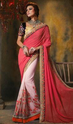 Salmon and Misty Rose Georgette Net Half N Half Saree Discover a brand new magic of vogue as you don this salmon and misty rose georgette net half n half saree. You could see some interesting patterns  done with floral patch, stones and velvet patch work. Comes with a matching stitched round neck blouse with 6 inches sleeves. #MistyRoseGeorgetteSaree #FancyEmbroideredBlousesSaree