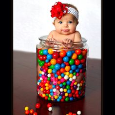 Baby girl in gum balls.  Colorful and cute!