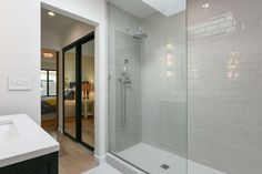 The master suite's spa bathroom offers a body sprayer in the tile shower. Photo: Open Homes Photography