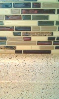 A close up view or our Bellagio Mosaik tiles. You can really see how the special 3D Gel was crafted to resemble real glass. We even took the liberty of mimicking the look of grout, and yet, no grout is needed to install our Smart Tiles. In a just a couple of minutes, you can have a brand new backsplash in your kitchen or bathroom. Just like this proud homeowner decided to do!