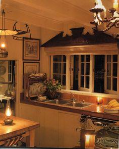 Romantic kitchen. I love how it's small but still feels open.
