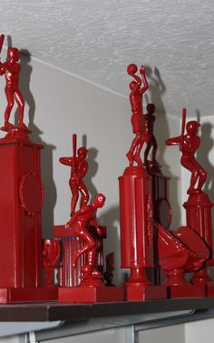 Great for a kid's room redo! Grab those old trophies at Goodwill and spray paint them! Great for all the sport theme rooms.