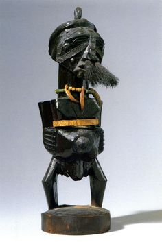 D.R. Congo, Songye Nkisi Power Figure; Wood, metal, hair, beads, animal teeth, leather H. 28,5 cm ; Thompson, Jerry L., Vogel, Susan: Closeup – Lessons In The Art Of Seeing African Sculpture; Exhibition Catalogue, The Center for African Art, New York, New York, 1990 and Prestel Verlag, Munich; Second printing 1991. S. 177