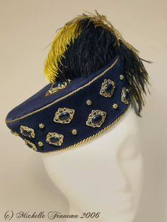 The Mistress Brydges--Navy velvet, gold cord, enameled findings, brass findings, ostrich feathers. Elizabethan bonnet designed and created by Michelle Fennema 2006.