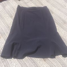 quality like new tulip skirt in navy w/back zip Like new navy poly rayon spandex skirt. Worn once.  Nice medium weight not thin. Any questions just let me know.  Get lowest prices and one low shipping cost with bundleAsk me how to get lowest shipping or  better prices with a bundle of two or more items. Briggs New York Skirts