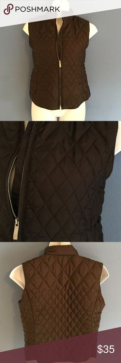"""📍New Listing📍 Talbots Brown Quilted Vest Who doesn't love chocolate?  These vest will have you wanting even more!  Quilted style.  Zippered front.  Two side zippered pockets. Pair with jeans or leggings.  Material:  64% Nylon/36% Polyester; Fill: 100% Polyester. Measurements:  Length - 23""""/Bust - 22""""/Waist - 21"""" Talbots Jackets & Coats Vests"""
