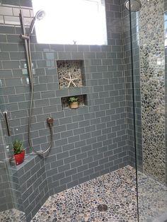 Large bali ocean pebble tile shower floor and wall