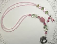 Pink and green glass beaded bookmarker (book thong) with heart and pink awareness ribbon charm. www.dabbledoos.com/bookmarkers.htm