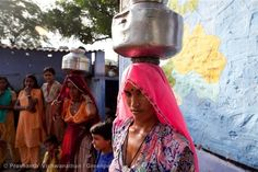 Women collect water at the solar-powered desalination plant in Kotri village, Rajasthan. Before the installation of the plant the local population would drink saline groundwater, with health problems as a result.