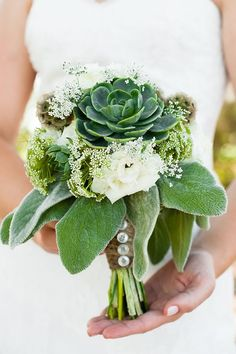 Succulent bouquet. Love the twine and buttons around the stems too.