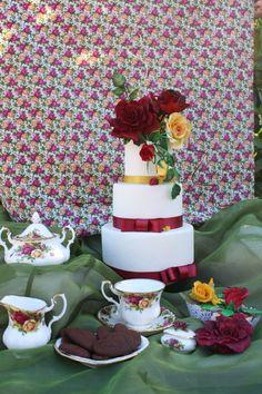 wedding cake; vanilla sponge with tiramisu cream decorated with icing sugar and hand made flower paste roses.