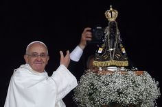 PROUD POPE: Pope Francis showed off the statue of the Madonna of Aparecida, whom Catholics venerate as the patroness of Brazil, in Aparecida, Brazil, Wednesday. This is the pontiff's first official papal trip outside of Italy. (Stefano Rellandini/Reuters)