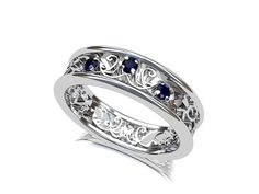 The blue sapphires in this ring have a very vivid color and the filigree detailing compliments them beautifully. The ring has 3pcs of 2.00mm