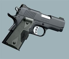 Kimber Ultra Carry II with Night Sights and Crimson Trace Laser Grip, 45ACP with Fired Shell Casing
