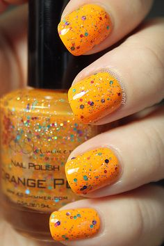 Orange Pop (is a glitter with purple, fuchsia and teal hexagons, smaller gold hexagons and fine multicolor glitter in a orange jelly base)