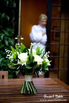 White roses bouquet with bride