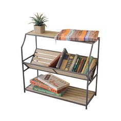 Combine simple style and charming display space and you've got the Clement Book Display Shelf. We couldn't resist the tilted center shelf that gives you a perfect view of all your favorite volumes. Und...  Find the Clement Book Display Shelf, as seen in the The Treehouse at Camp Wandawega Collection at http://dotandbo.com/collections/the-treehouse-at-camp-wandawega?utm_source=pinterest&utm_medium=organic&db_sku=100972
