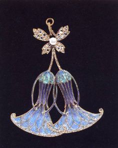 Alphonse Mucha pendant, 1907-08. Cloisonné enamels with gold, diamonds and a pearl.