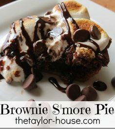 Brownie S'more Pie that's loaded with chocolate and topped with gooey marshmallow topping #smores #brownie #recipes