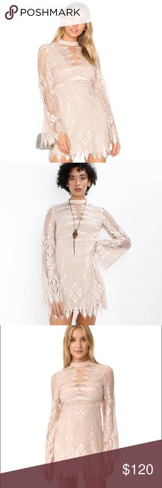 Free People Deco Lace Mini Dress Deco-inspired fit and flare lace mini dress featuring a high neck with a sheer mesh insert on the bust and an open cutout in back. Dramatic bell sleeves and uneven trim throughout with eyelash lace detailing. Hidden side zip closure.  90% Nylon 10% Polyester Hand Wash Cold Import Free People Dresses Mini