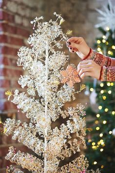 FP One Glitter Tree | Free People Add a piece of glittery magic this holiday season and make a sparkly statement with this ethereal, artificial Christmas tree, made with wire binding.