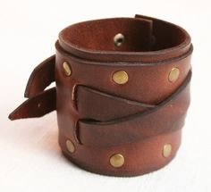 Mens vintaged brown leather cuff bracelet with three adjustable sizes, held in place with two solid brass collar studs. It is made with a
