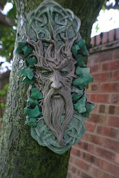 Green Man Garden Ornament - not really 'growing things', but I would love to put in my garden