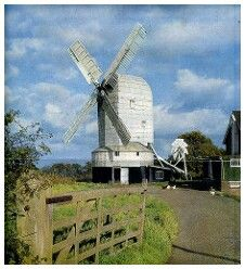 The New Mill, Cross In Hand, near Heathfield, East Sussex in 1965. Erected here in 1868 having previously stood at Mount Ephraim, near Uckfield, to stand alongside a smaller post mill which was demolished in 1905 but the roundhouse still stands. The New Mill was the last commercially working windmill in Sussex, finally ceasing work in 1969 when a sweep broke off. Today the mill has no sails and is in a ruinous condition, although some essential repairs were carried out recently.
