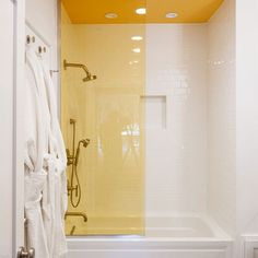 Who says glass shower stalls have to be clear? Look at this yellow one, seamlessly blending with the yellow ceiling. Togadera - Oceanfront Home - Seabrook Washington Vacation Rentals Yellow Bathroom Decor, Yellow Bathrooms, Bathroom Colors, White Bathroom, Inspiration Design, Bathroom Inspiration, Casa Top, Built In Bathtub, Bathroom Color Schemes