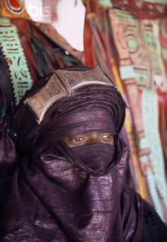 Tuareg man. Among the Tuaregs, it's the men who are veiled. It's a rite of passage into manhood for them. The women, traditiionally are not veiled.