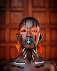 Close-up Photography of Woman With Tribal Face Paint · Free Stock Photo Tribal Body Paint, Tribal Face Paints, African Makeup, African Beauty, Paint Photography, Face Photography, Cara Tribal, Pintura Tribal, African Face Paint