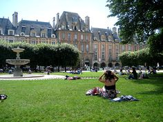 Place des Vosges - the only place in Paris people sit on the grass