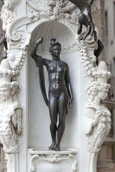 This intricate statue is in Piazza Della Signoria under the Loggia Dei Lanzi in Florence, Italy