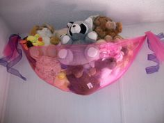 homemade stuffed animal net for Lilys room, 2 yards of tulle, ribbon & command hooks