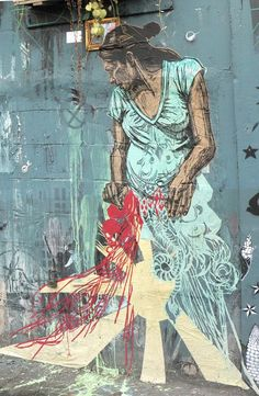 Swoon is a street artist with a classical painting background.She celebrates the people that make up the cityscape and pastes their images around New York City where she lives. The city is her canvas for telling stories. Swoon creates entire imaginary cities out of found objects, cut paper and prints. Magical