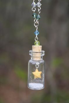 Items similar to Paopu Suspended Star Bottle Necklace on Etsy Bottle Jewelry, Bottle Charms, Bottle Necklace, Bottle Art, Origami Gifts, Diy Origami, Origami Bird, Origami Flowers, Origami Paper