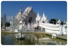 The White Temple, Wat Rong Khun, in Chiang Rai in Northern Thailand is the most unconventional temple we've ever visited! Read more about this strange building: