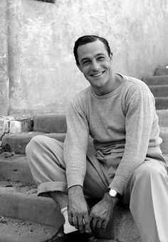 One of my favorite photos of Gene Kelly. Love the socks, the rolled up cuff, the smile, the guy.