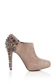 oh my gosh. my favorite pair of heels in boot form. I'm going to need a job so I can buy both of those.
