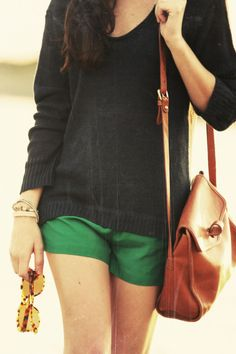 Green shorts, sweater, and a camel cross body bag