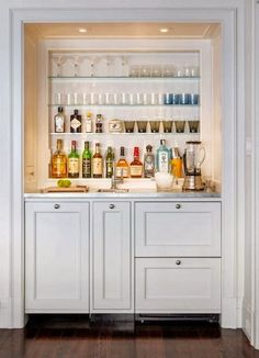 Bottom cabinet set-up for kitchen island. Wine fridge instead of pair of drawers, and glassware stored under cabinet on the left. Only in our island, the wine fridge is on the left.