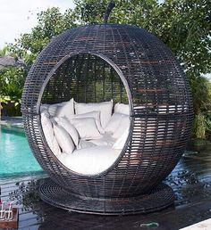 I stand corrected . . . being in THIS chair would be a little like being in Jeannie's genie bottle! And, subtle creature that I am, I'd do this in hot pink and orange, with celadon green, emerald green and pale pink accent pillows.  And probably some sequins and mirrored tiles, too . . . you know, keeping it simple! ;)