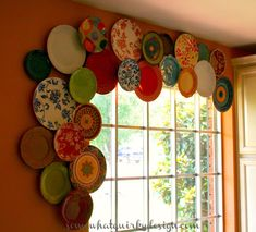 Plate Valance - from Somewhat Quirky - background plates are hung with regular plate hangers. Foreground plates are hung with the hangers on small blocks of wood which are nailed to the wall to give height. I think it looks great!