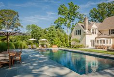 Custom-designed fire pit, pool and jacuzzi with automatic covers #pool #backyard