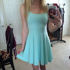 Mint Dress Adorable mini mint or seafoam green dress. Flowy, stretchy, and comfortable material. Never worn and in perfect condition H&M Dresses