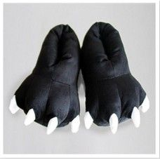 Black Monster Slippers One size fits all (up to mens size 11) To keep your feet toasty warm ..25% off EVERYTHING in store. Free Express Delivery Australia-wide. Visit www.crazyonesie.c... for more details. Visit our Facebook page www.facebook.com/... for exclusive competitions and discounts