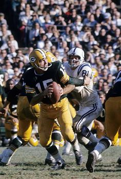 BAY WI CIRCA Bart Starr quarterback of the Green Bay Packers drops back to pass against the Baltimore Colts during a circa NFL game at. Go Packers, Packers Football, Dallas Cowboys Football, Football Season, Greenbay Packers, Football Players, Baltimore Colts, Indianapolis Colts, Pittsburgh Steelers