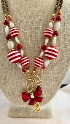 Your place to buy and sell all things handmade Red Candy, Candy Cane, Christmas Necklace, Art Deco Wedding, Candy Stripes, White Beads, Christmas Candy, How To Make Beads, Repurposed